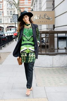 """Bev Malik, buying consultant  """"I'm wearing a dress by Mary Katrantzou with a Topshop jacket, YSL trousers and a Catarzi hat. The jewellery is by Lizzy Fast and my bag I brought back from a trip to Goa."""""""