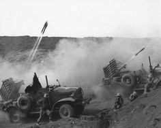 U.S. Marine rocket-launching trucks in action on Iwo Jima, February, 1945.