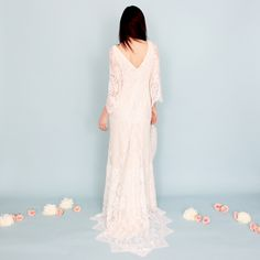 A stunning bohemian lace dress with v-neck and bell sleeves. This gorgeous vintage-inspired lace is as soft as a feather. Scalloped edges adorn the sleeves and hem.