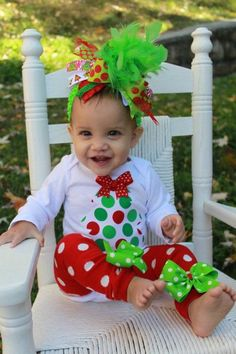 Baby Girl Christmas outfit SET -- Grinch inspired -- bow, leg warmers and onesie -- Over The Top and fabulous. $49.95, via Etsy.