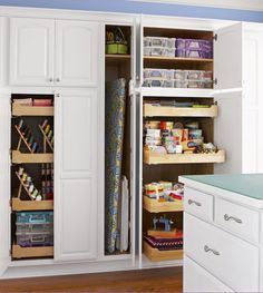Kimberly Einmo's sewing room is packed with smart storage. Pullout drawers make every inch of space accessible. The drawers hold precuts and vertical thread racks sorted by color. Stackable, see-through caddies organize in-process projects, fabrics, and less-used tools. An oversize ironing board fits comfortably in a skinny broom cabinet.