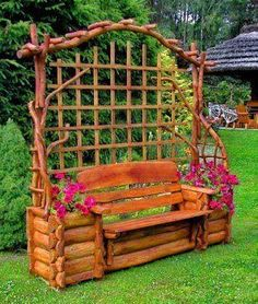 Rustic bench, perfect for clematis growing on the trellis behind it.