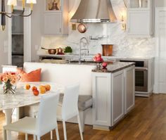 transitional white kitchen with island.