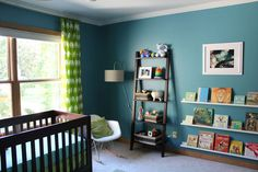 teal walls with espresso furniture and white trim