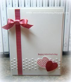 Stamp Sets: Hearts a Flutter, Teeny Tiny Wishes  Cardstock: Primrose Petals, Whisper White  Ink: Primrose Petals, Raspberry Ripple  Tools: Adorning Accents Embossing Folder, Hearts a Flutter Framelits  Accessories: Primrose Petals Stitched Satin Ribbon