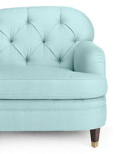 because rooms should be mix-and-match affairs of hand-curated pieces acquired from travels near and far--plus pretty forever pieces, like this tufted sofa in a gorgeous aqua hue (a perfect place for curling up with your favorite well-worn book).