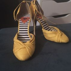Yellow Rocket Dog high heels Rocket Dog Olivia high heels. Yellow Thai silk upper. Knotted round toe. Ankle strap with adjustable buckle. 3 3/4 covered heel. Synthetic sole. I never wore them outside, only  worn a few times around the house, they are so pretty but too tall for me! Rocket Dog Shoes Heels