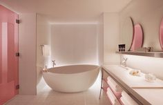 Love the mirrors on the shelf. Beautiful original  use of pink glass.