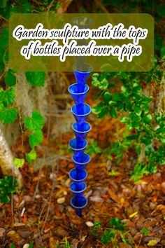 Garden Sculpture from Upcycled Bottles - photo inspiration. Cut bottles with bottle cutter, smooth edges, invert over pipe