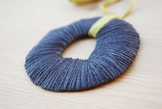 Ceramic pendant,  textured refractary black clay. €17.50, via Etsy.