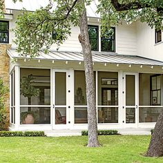 Elevated slightly above ground and cloaked in a tall stand of shady oaks, the southeast-facing abode takes advantage of meadow views from every angle.