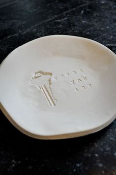 Clay Bowl, just press your key in some clay. Easy Diy. Love it! Great for other random things in the house too