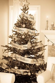 The garland could be recreated by printing Christmas sayings on paper of your choice, cut to width you want, then sew or glue the ends together. Trim edges with scallop scissors.