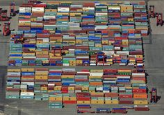"""Bird's Eye View Photography.  Container Terminal in Hamburg. Klaus Leidorf takes aerial photos, mostly in Bavaria, South Germany. He pilots a Cessna 172, taking photos while he steers with his feet. """"For me, the challenge is to capture the combination of the beauty of nature, the graphic aspect and the emotion."""""""