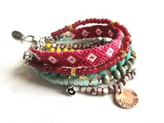 Bohemian hippie bracelet - pink and turquoise beads and friendship bracelet - gypsy style - multiple strands. €78,00, via Etsy.