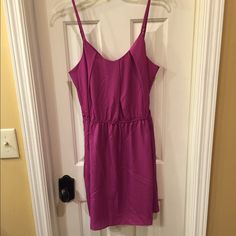 BCBGeneration NWT spaghetti strap dress size M NWT pullover style dress has adjustable spaghetti straps and a 2 button back closure Berry colored dress has a self fabric liner and an elastic waist for the perfect fit Size M retail tag attached no flaws BCBGeneration Dresses Midi