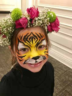 A girl who got a tiger face painting