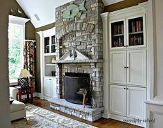 media built in cabinets around a fireplace | Built in cabinets around the fireplace