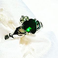 Emerald Claddagh Ring In Sterling Silver, Handmade Jewelry By NorthCoastCottage Jewelry Design & Vintage Treasures. The claddagh ring (Irish: fáinne Chladaigh) is a traditional Irish ring given to represent love, loyalty and friendship. The hands represent friendship, the heart or