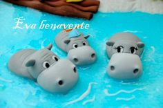 Hippos wading in water