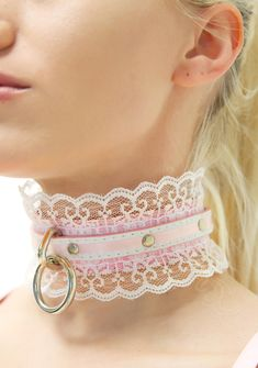 NecroLeather Victorian Wedding Bondage Collar wants to lock yew in, bb. This elegant choker features a hand-painted baby pink vegan leather that is covered with frilly white lace, and topped with an overlay of pink ribbon. With a silver toned O-ring, this choker is complete with a buckle fastener.