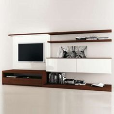 One of my favorites, this TV blends in, because it continues the long, clean lines of the shelves.   Source