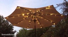 ), we bought a patio umbrella that lacked a little pizzaz. Our patio table was one of our favorite relaxation spots, but also had li… Patio Umbrella Lights, Patio Umbrella Stand, Offset Patio Umbrella, Outdoor Patio Umbrellas, Outdoor Umbrella, Tent Lighting, Backyard Lighting, Lighting Design, Led Outside Lights