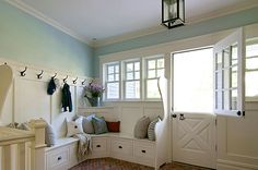 A Dutch door, wall of windows and beatifully detailed built-ins makes this generously sized mudroom an inviting space. By BHDM Design, via House of Turquoise. House Of Turquoise, Turquoise Walls, Home Interior, Interior Decorating, Decorating Ideas, Interior Design, Brick Flooring, My Dream Home, Home Remodeling