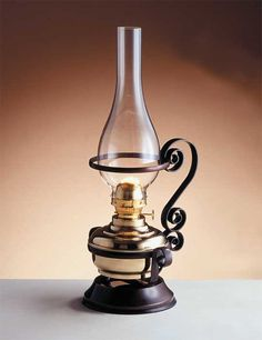 Be still my beating heart! I want a cast iron lamp holder to add to my collection. This is positively genius!