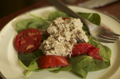 simple. easy. under 300 calorie lunch. a new twist to tuna salad. on a bed of spinach and tomato's...YUMMY!