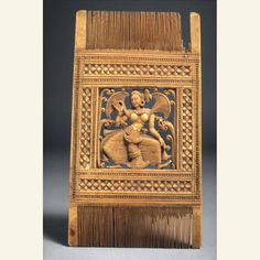 Comb with dancing woman Date: approx. 1700-1800 Medium: Ivory Place of Origin: Sri Lanka | former kingdom of Kandy Credit Line: The Avery Brundage Collection Dimensions: H. 14.0 cm x W. 8.3 cm x D. 0.3 cm ASIAN ART MUSEUM, San Francisco