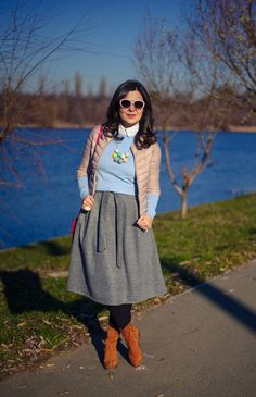 Winter pastels: midi skirt, grey skirt, blue sweater, dusty pink jacket, brown boots, statement necklace