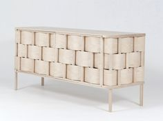Weave by Swedish designer Lukas Dahlén. Inspired by the most common kind of wood and weed weaving the Weave cupboard represents an enlarged version of the technique of weaving something soft around a more stable structure.