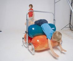 The Squeeze Machine from TFH provides deep proprioceptive input for children with sensory processing disorder caused by a range of conditions including Autism. Proprioceptive Input, Sensory System, Sensory Integration, Soft Play, Sensory Processing Disorder, Helping Children, Soft Plastic, Special Needs Kids, Sensory Toys