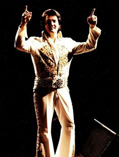 June 26, 1977 - Elvis Presley gestures at the crowd during his last performance in Indianapolis