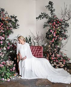 Between the #velvet settee, caped gown and abundant surrounding florals, we can't picture a dreamier bridal portrait setting! #repost @kwhbridal #Floral @ohflorastudio #Photography @sophjthompson
