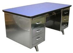 I've been agonizing about whether to take my so-utilitarian Tanker Desk — An American Modern Classic. Anyone know how to make it look something like this? Any other ideas?  Thanks!