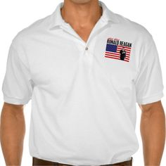 """President Ronald Reagan """"God Bless Ronald Reagan"""" Polo shirts. The Gildan Jersey Polo Shirt is a must-have for summer days. Made of 100% cotton, this top will keep you comfortable no matter how hot the weather gets. Wear it while doing yardwork, playing volleyball on the beach, or simply hanging out."""