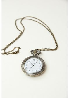 Only 1 left! Never be late again with this whimsical Wonderland Clock Necklace!
