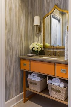 This bathroom has faux painted walls and a gorgeous orange cabinet  - Tobi Fairley Interior Design