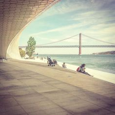 25 de Abril Bridge as seen from the Museu de Arte Arquitetura e Tecnologia. #architecture  #bridge #landmark / #maat #Belém #Lisbon #Portugal
