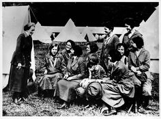 Juliette Gordon Low and some Girl Scouts talking and laughing