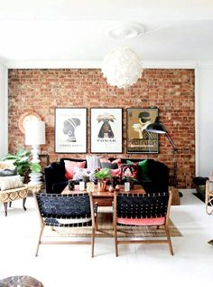 Bohemian Scandinavian living space with exposed brick walls and rose-gold accessories