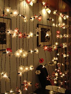 DIY Project: Mood lighting for wedding by fubabee, via Flickr   These are all battery operated Christmas light strands. The bridesmaids used flower punches to create the flowers, and popped it all into the bulbs by hand.