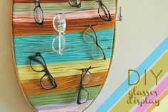 : of my favorite things posted in this DIY Pin! This glasses organizer is made from an embroidery hoop with wrapped thread. I love this project that was shared by www.nearsightedowl.com. #glasses #organizer #DIY