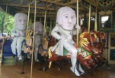 Rushmore Mascots in riding a carousel at Worlds of Fun. Enter to win a vacation to SD www.travelsd.com/rushmoremascots