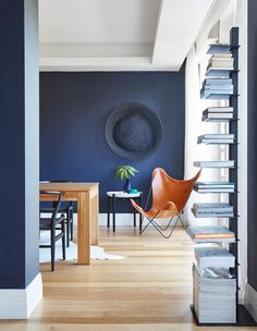 Navy blue walls are always a classic but they feel fresh and new in this contemporary space.