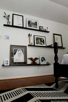 Great way to fill a large, empty wall: floor to ceiling IKEA picture ledges. @ Make Them Wonder Blog