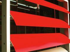 Personality and Performance. Hunter Douglas Sun Louvre Systems. #architecture #façade #red #hunterdouglas