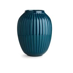 Hammershøi Vase Petrol Large   See the centrepiece vases from Kähler's Hammershøi range. The petrol vase elegantly matches the rest of the Hammershøi range and features the distinctive furrows that tie the range together. Use the large vase as an elegant design object on the table or in the hallway where it will give your guests a beautiful and warm design welcome.
